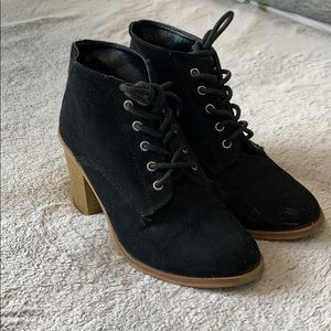 Black lace up booties with wood-look heels